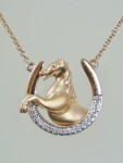 Rose Gold Diamond Horse Shoe Necklace With A Rose Gold Horse